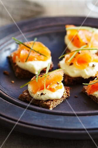 Rye bread crackers topped with smoked salmon and cream cheese