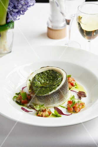 Spinach Souffle wraped with a fish fillet served with salsa