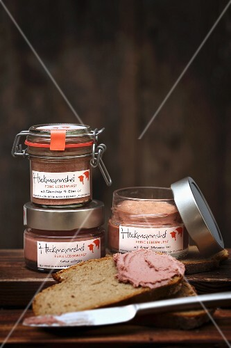 Liver pâté in jars and on a slice of bread