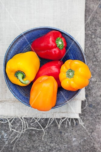 A bowl of colourful peppers (seen from above)