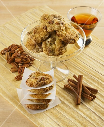 Pecan nut and cinnamon cookies with a glass of whiskey