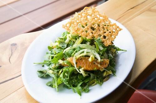 Green salad with orange fillets and a Parmesan crisp