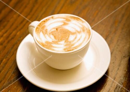 A cappuccino with decorative foam