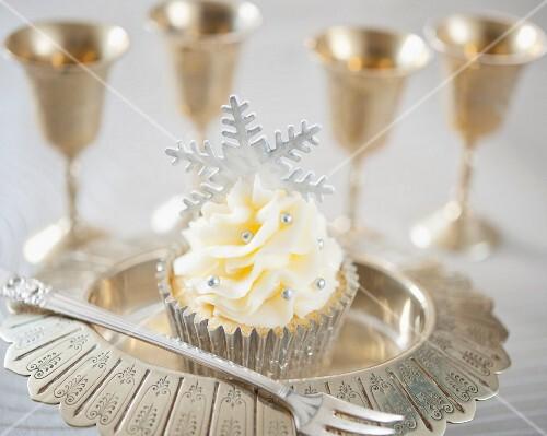A festive Christmas cupcake with silver fondant snowflake