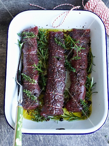 Marinated venison fillets with olive oil and herbs