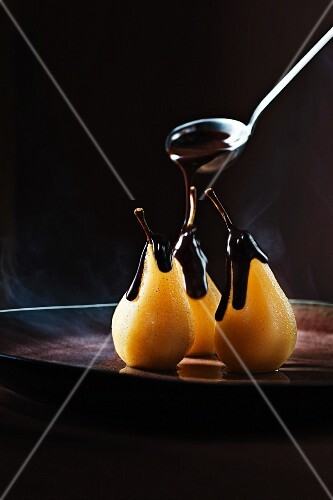 Poached orange and spiced pears with warm chocolate ganache