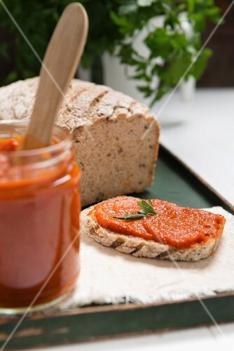 Ajvar (pepper mousse) in a jar and on a slice of bread