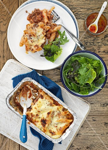 Pasta bake with minced meat and mixed leaf salad