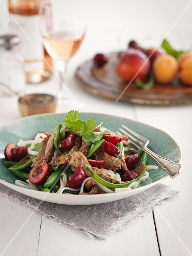 Pork with cherries, vegetables and noodles