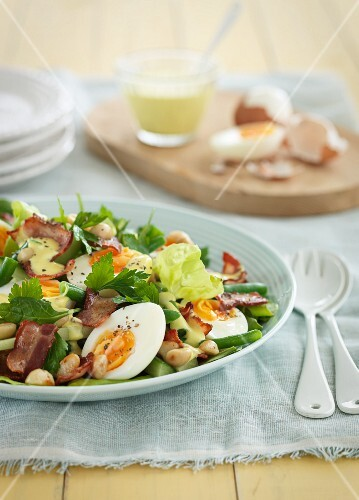 Egg salad with vegetables and bacon for Easter