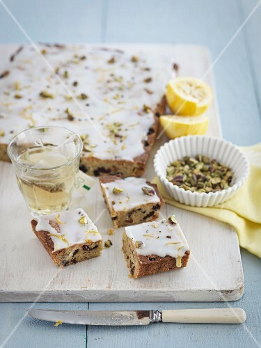 Fruit cake with nuts and lemon glaze