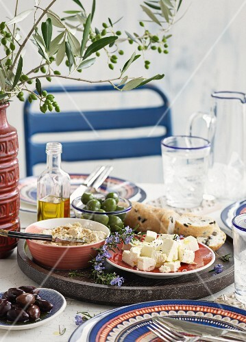 A table laid with various appetisers from Greece