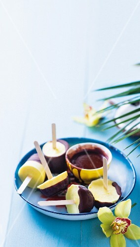 Pina colada ice cream sticks with chocolate glaze