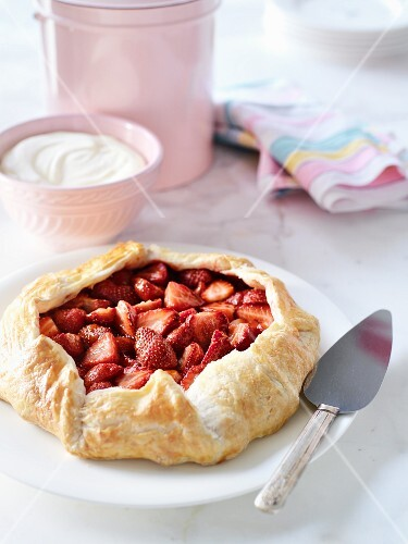 Strawberry pie with cream on a marble table