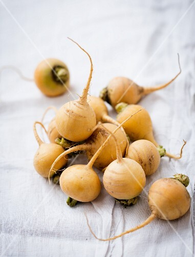 Golden beets on a white cloth