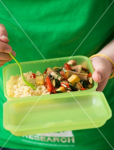 Couscous with vegetables in a Tupperware box