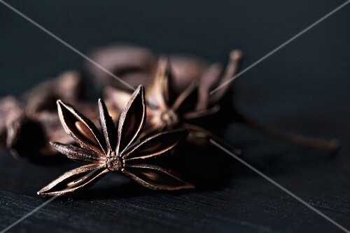 Star anise on a black wooden table