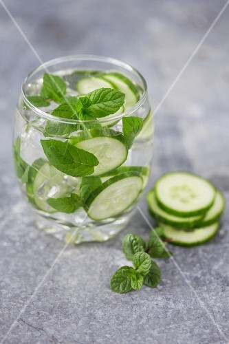 Water flavoured with cucumber and fresh mint with ice cubes
