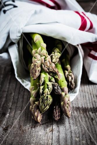 Green asparagus in a tea towel