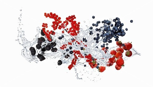 A splash of water with berries