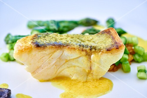 Seabass with butter sauce and black garlic