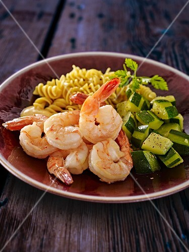 Prawns with a courgette medley and pasta