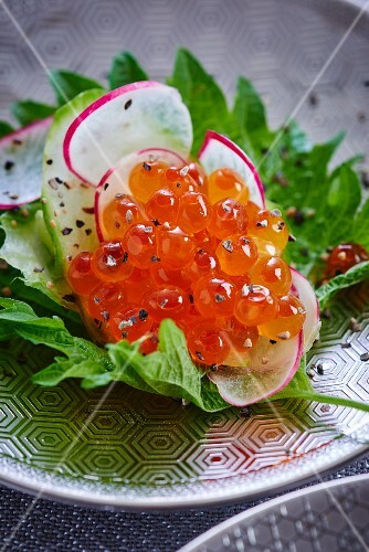 Salmon caviar and radishes on shiso leaves