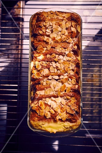 Pain perdu terrine with flaked almonds (seen from above)