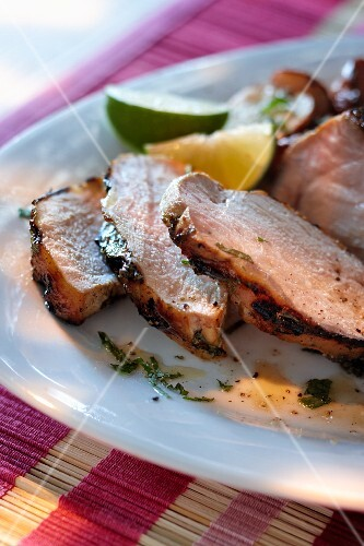Grilled pork steak with a lime and mint sauce