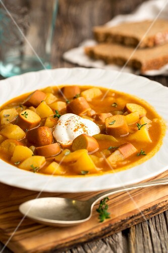 Potato soup with curry and vegan frankfurters