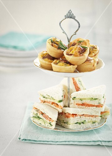 Sandwiches and spicy tartlets on a cake stand