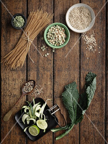 An arrangement of pasta, seeds and cabbage leaves