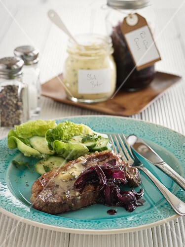 Beef steak with herb butter and onion confit