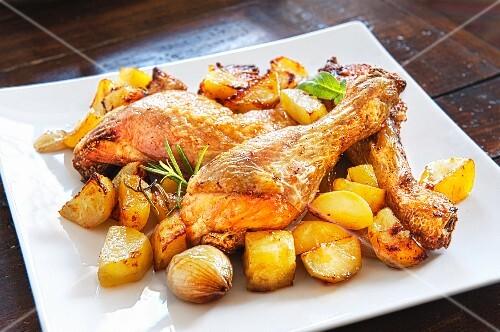 Roast chicken with potatoes, garlic and rosemary