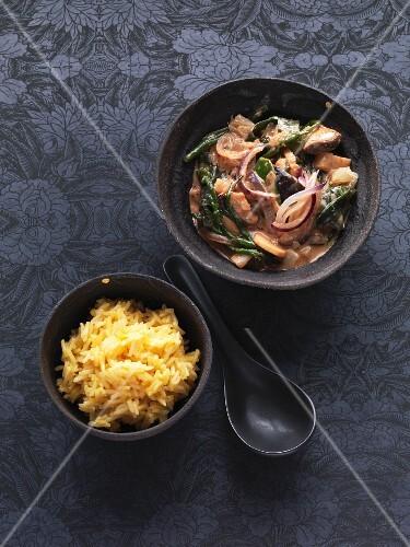 Vegan stir fry with wakame algae and passion fruit rice