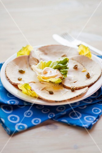 Roast turkey served with capers and mayonnaise in a lettuce leaf