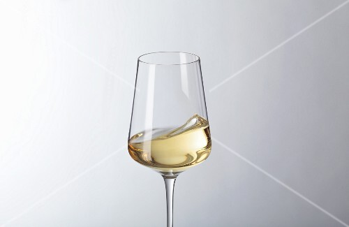 White wine swilling in a glass