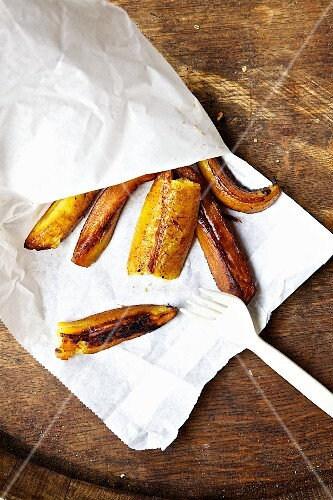 Grilled plantains in a paper bag