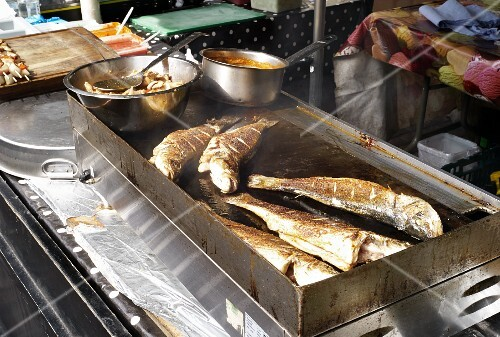 Fried fish in a street shop at a market (Covent Garden, London)