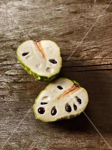 A custard apple, halved