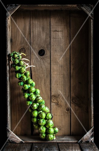 Brussels sprouts in a wooden crate