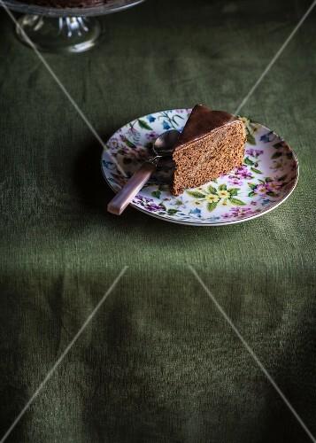 A piece of Sachertorte (chocolate cake) on plate