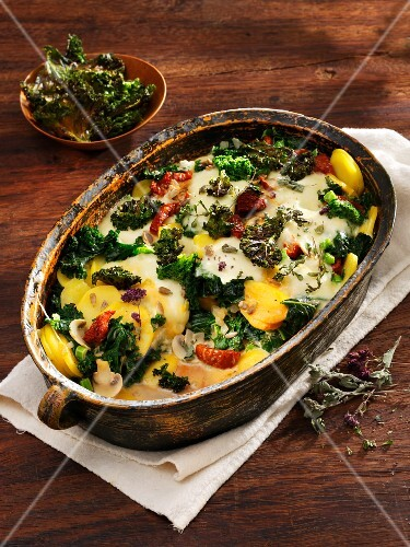 Potato and kale gratin with sunflower seeds and mushrooms