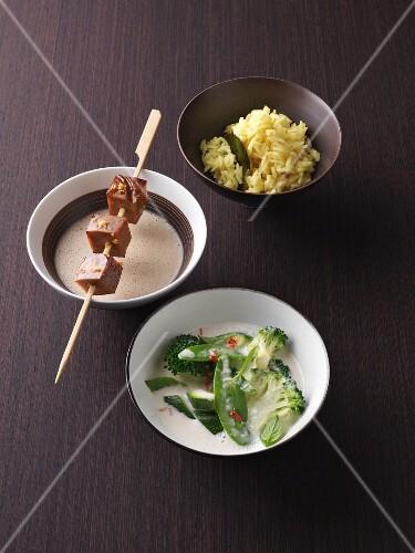 Seitan satay with peanut sauce and aromatic turmeric rice