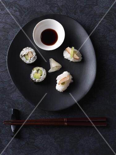 Vegan nigiri and maki sushi with tofu, radishes and cucumber