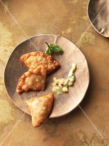 Indian lentil samosas and fresh mango raita