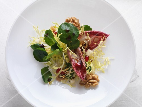 Watercress salad with a cassis dressing and walnuts