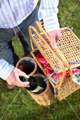 A picnic basket with wine