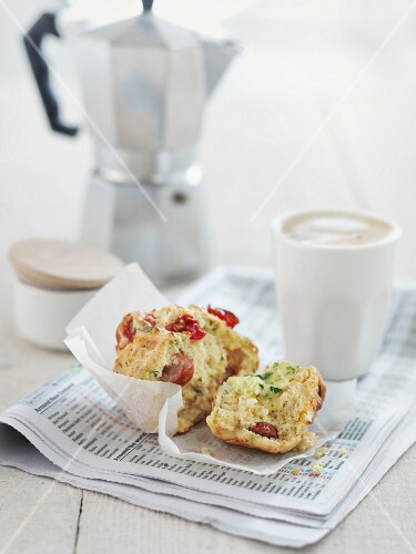 Spicy breakfast muffin, coffee and a newspaper