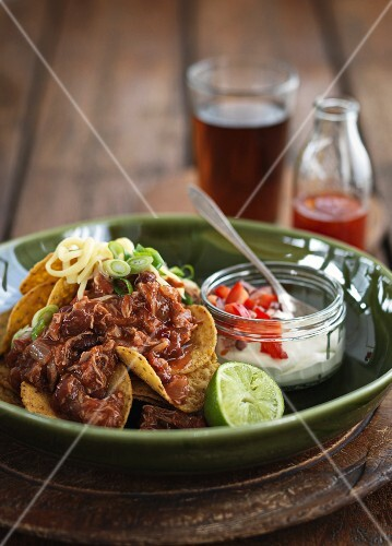 Chicken nachos with cheese, spring onions and sour cream